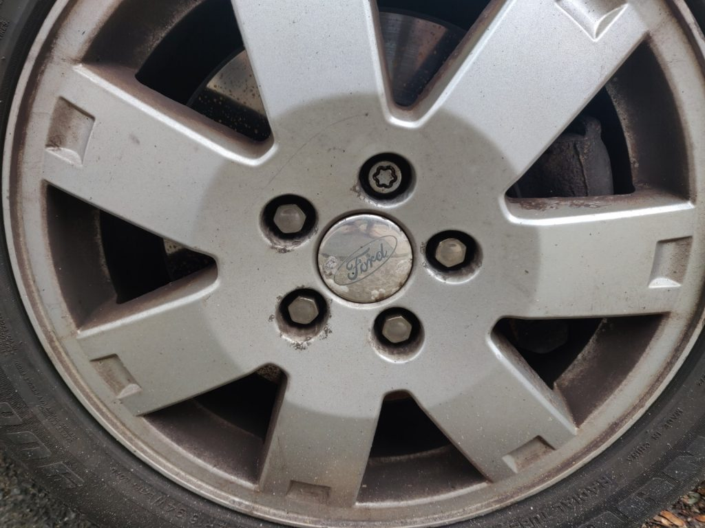 Locking wheel bolts are an effective security addition. Not cleaning the wheels helps too.